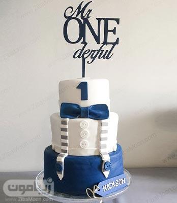 مدل کیک تولد پسرانه یک ساله با فوندانت به رنگ سفید و آبی