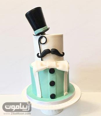 کیک تولد پسرانه فوندانتی دو طبقه به رنگ سفید و سبز
